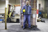 Man standing in warehouse — ストック写真