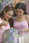 Young woman looking in shopping bags — Stock Photo