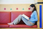 Barefoot teenage girl reading — Stock Photo