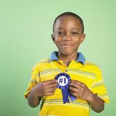 African boy holding birthday ribbon — Stock Photo