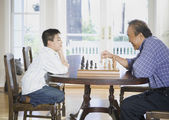 Asian grandfather and grandson playing chess — Stock Photo