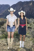 Lesbian couple in cowboy outfits posing for the camera — Stock Photo