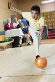 Man throwing bowling ball at bowling alley — Stock Photo