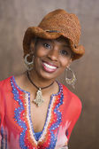 Portrait of African American woman wearing hat and smiling — Stock Photo