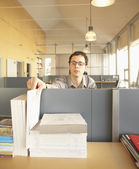 Businessman stealing paper from a colleague — Stock Photo