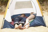 Couple laying in tent — Stock Photo