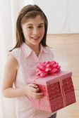 Irish girl holding gift — Stock Photo