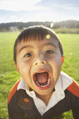 Young boy making a funny face — Stock Photo