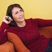 Hispanic woman listening to headphones — Stock Photo