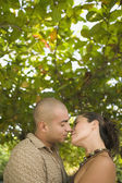 Couple kissing outdoors — Stock Photo