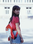 Rear view portrait of girl with guitar on back — Stock Photo