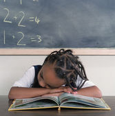 School girl sleeping on book — Stock Photo