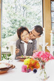 Couple kissing at the dinner table — Stock Photo