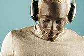 Young man listening to headphones — Stock Photo