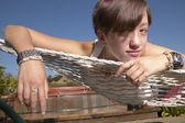Portrait of teenage girl laying on hammock — Stock Photo