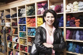 Female customer in yarn shop — Стоковое фото