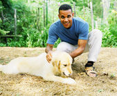 Man petting dog — Stock Photo
