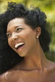 Close up of South American woman laughing — Stock Photo