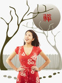 Portrait of Asian woman with hands on hips — Stock Photo