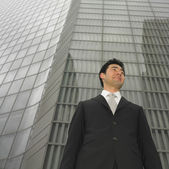Low angle view of businessman next to building — Stock Photo