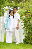 Portrait of a couple standing together on a lawn — Stock Photo