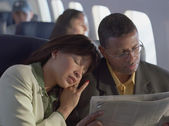 Mature couple relaxing on airplane — Stock Photo