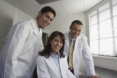 Group portrait of doctors smiling — Stock Photo