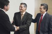 Hispanic businessmen shaking hands — Stock Photo