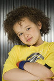 Young African girl with arms crossed — Stock Photo