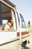 Young girl riding in a recreational vehicle — Stock Photo