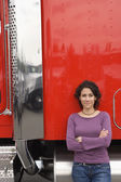 Young woman standing by her truck — Stock Photo