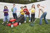 Multi-ethnic children doing yard work — Stok fotoğraf