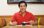 Portrait of Asian man eating rice — Stock Photo