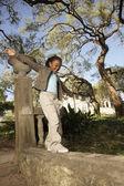 African American girl balancing on wall — Stock Photo