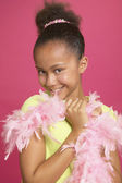 African girl wearing feather boa — Stock Photo