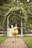Young Hispanic girl wearing bumble bee costume — Stock Photo