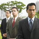 Three businessmen standing in row — Stock Photo