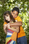 Hispanic brother and sister hugging — Stock Photo