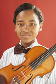 African boy holding violin — Stock Photo