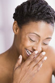African American woman laughing — Stock Photo