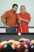 Hispanic grandfather, father and son playing pool — Stock Photo
