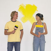 Couple painting a wall — Stock Photo