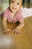 African baby laying on floor — Stock Photo