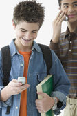Two teenage boys standing with cell phones — Stock Photo