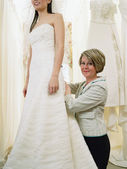 Young bride-to-be trying on her gown — Stock Photo