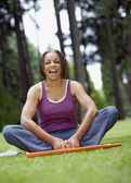 Senior woman stretching in park — Stock Photo