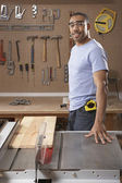Portrait of man with table saw — Stock Photo