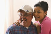 Portrait of young adult woman with her father laughing — Stock Photo