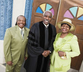 Portrait of senior African American couple and Reverend — Stock Photo