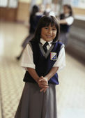 Young girl in private school uniform — Stock Photo